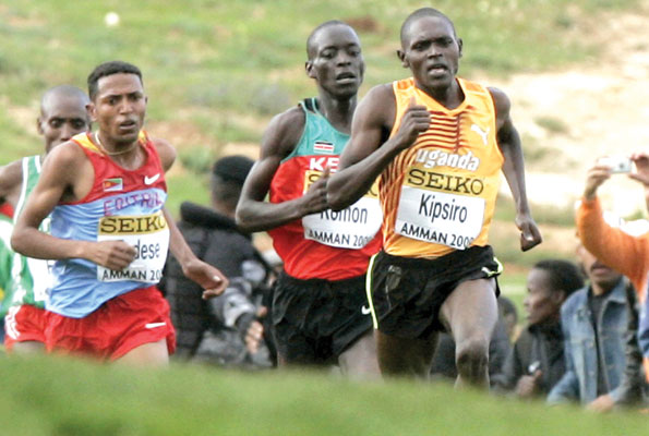 Uganda's long distance star Moses Kipsiro picured right enroute to winning a silver medal at the 2009 World Cross Country Championships in Amman Jordan