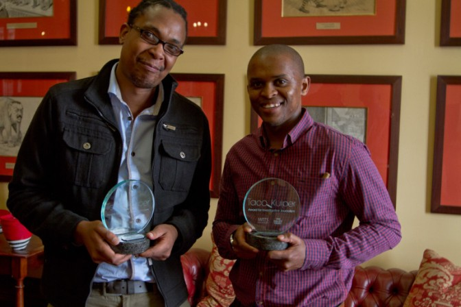 "Winners: Msindisi Fengu and Yandisa Monakali of the Daily Dispatch, for ""Hostels of Shame."" Credit: TJ Lemon"